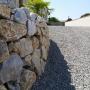 Mur-pierre-sèche-tête-d'homme-terrain-en-pente-paysagiste-31