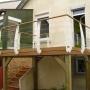 Terrasse sur pilotis avec garde-corps galbés