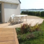 Une terrasse aller de la maison à la mer