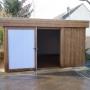 Abri de jardin à toit plat et porte coulissante